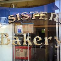 FOUR SISTERS BAKERY logo